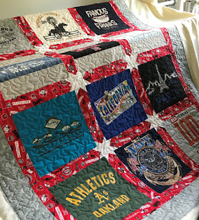 red and grey borders around t-shirt quilt blocks made by Amy