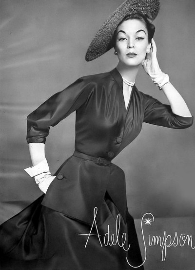 Jean Patchett in dark colored dress with hat and white gloves for Adele Simpson 1952 ad