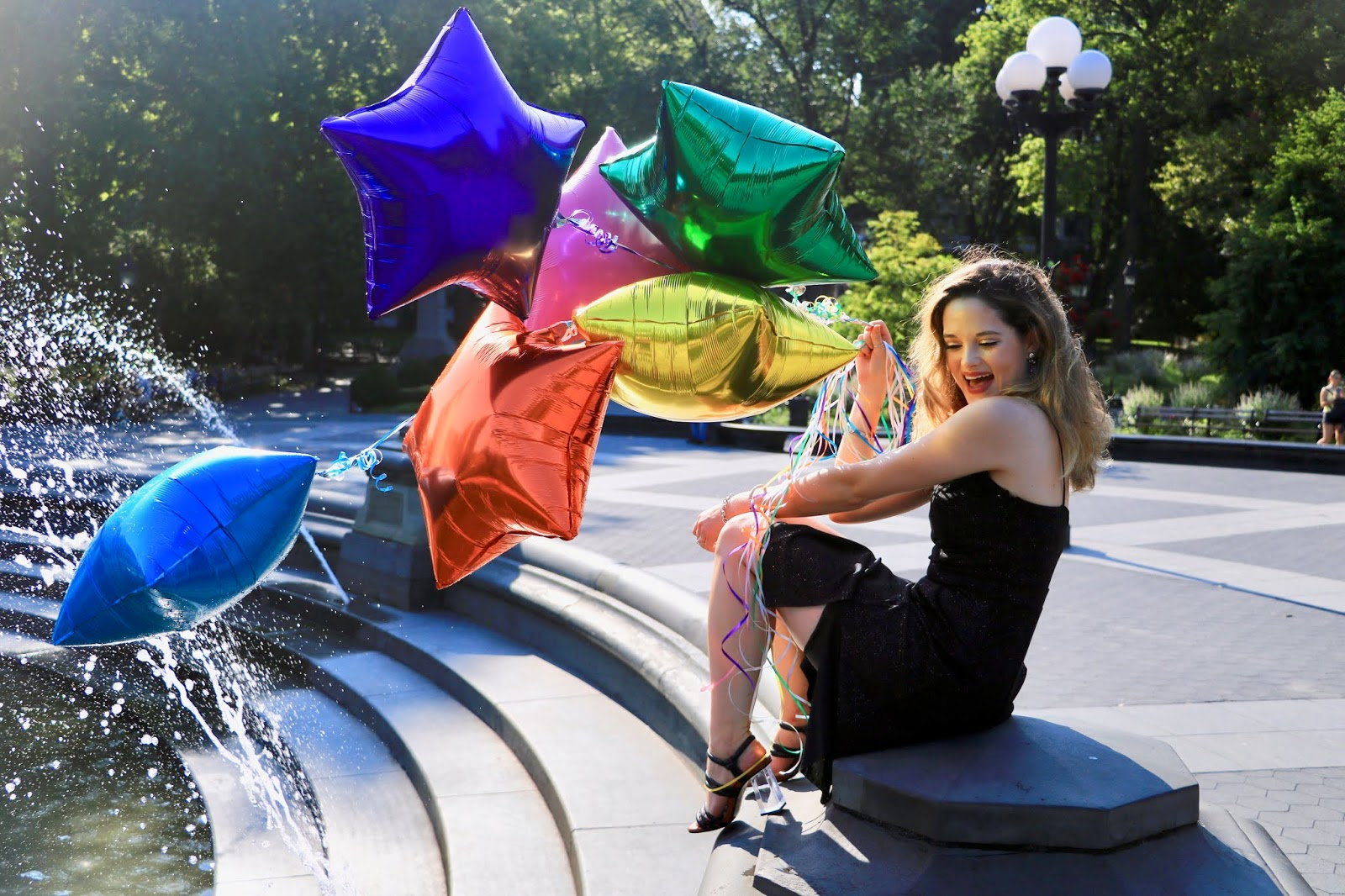 Nyc fashion blogger Kathleen Harper's photo shoot with star-shaped balloons.