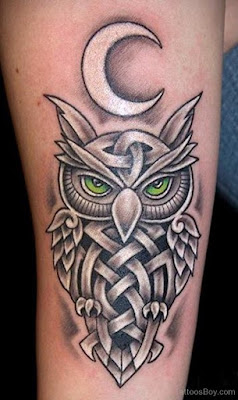 What does an owl tattoo symbolize?