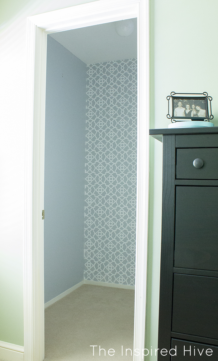 Part one of a beautiful walk in closet makeover! How to stencil a feature wall using Royal Design Studio stencils.