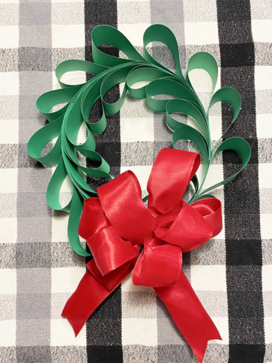 green wreath with red bow