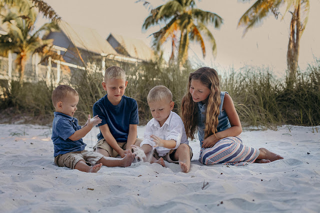 children getting candid pictures on the beach on sanibel