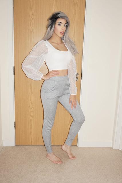Femme Luxe Grey Cuffed Pocket Detail Joggers in model Teddy