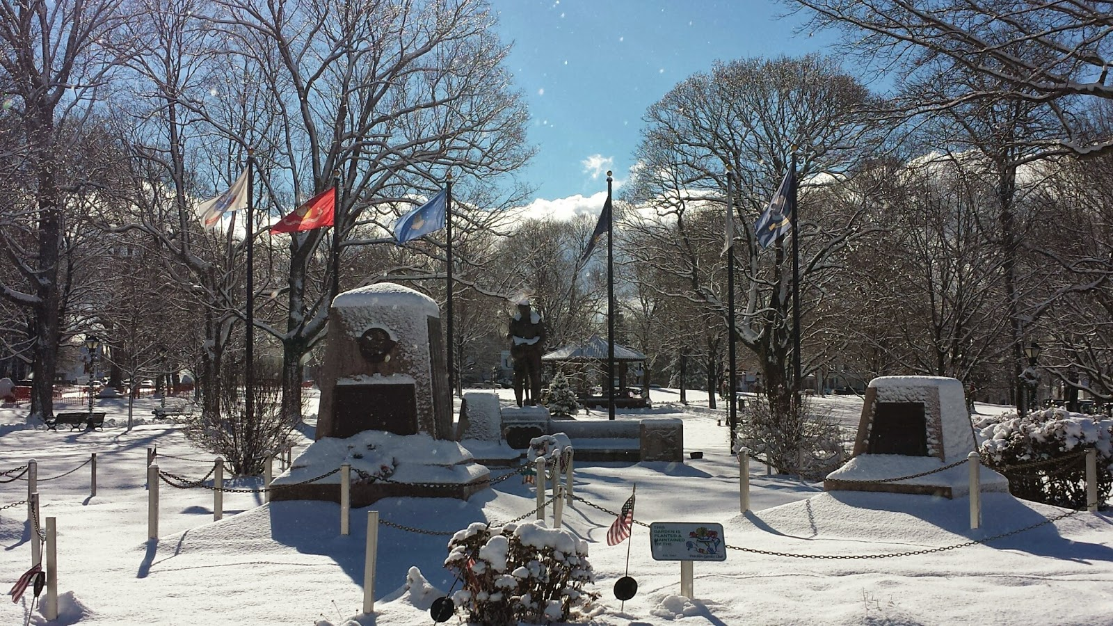 the war memorials on the Town Common decorated with snow
