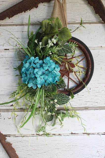 upcycled wheel wreath or door hanging.
