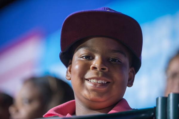 image of a little Black boy with a big grin at a Hillary rally