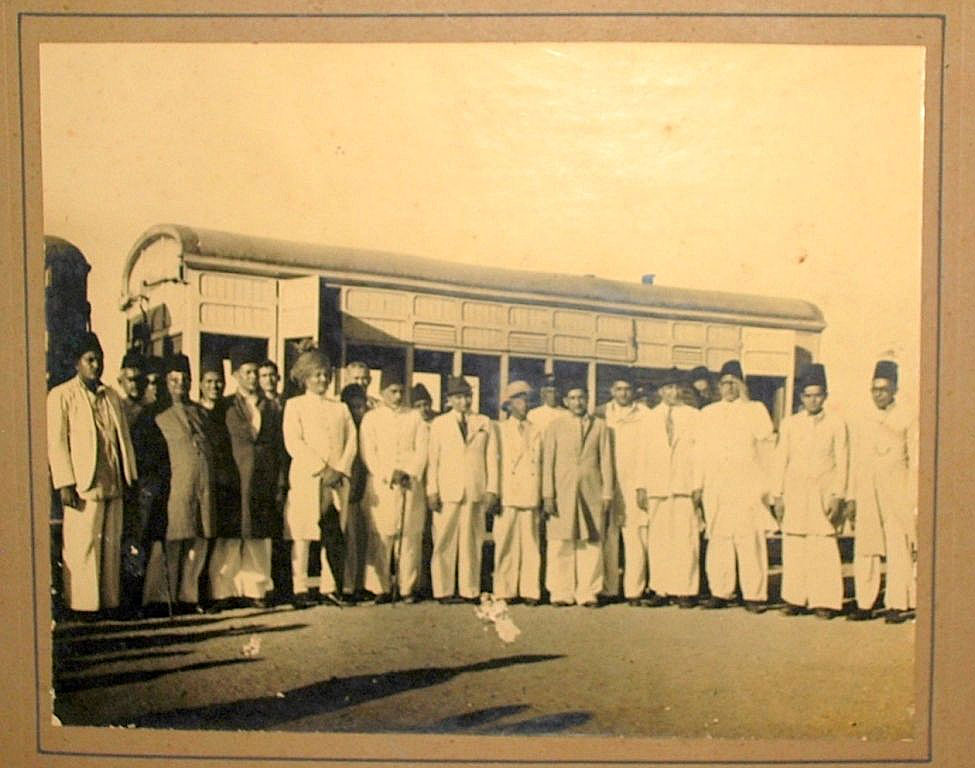 Group of People in front of a Train - India, Date Unknown