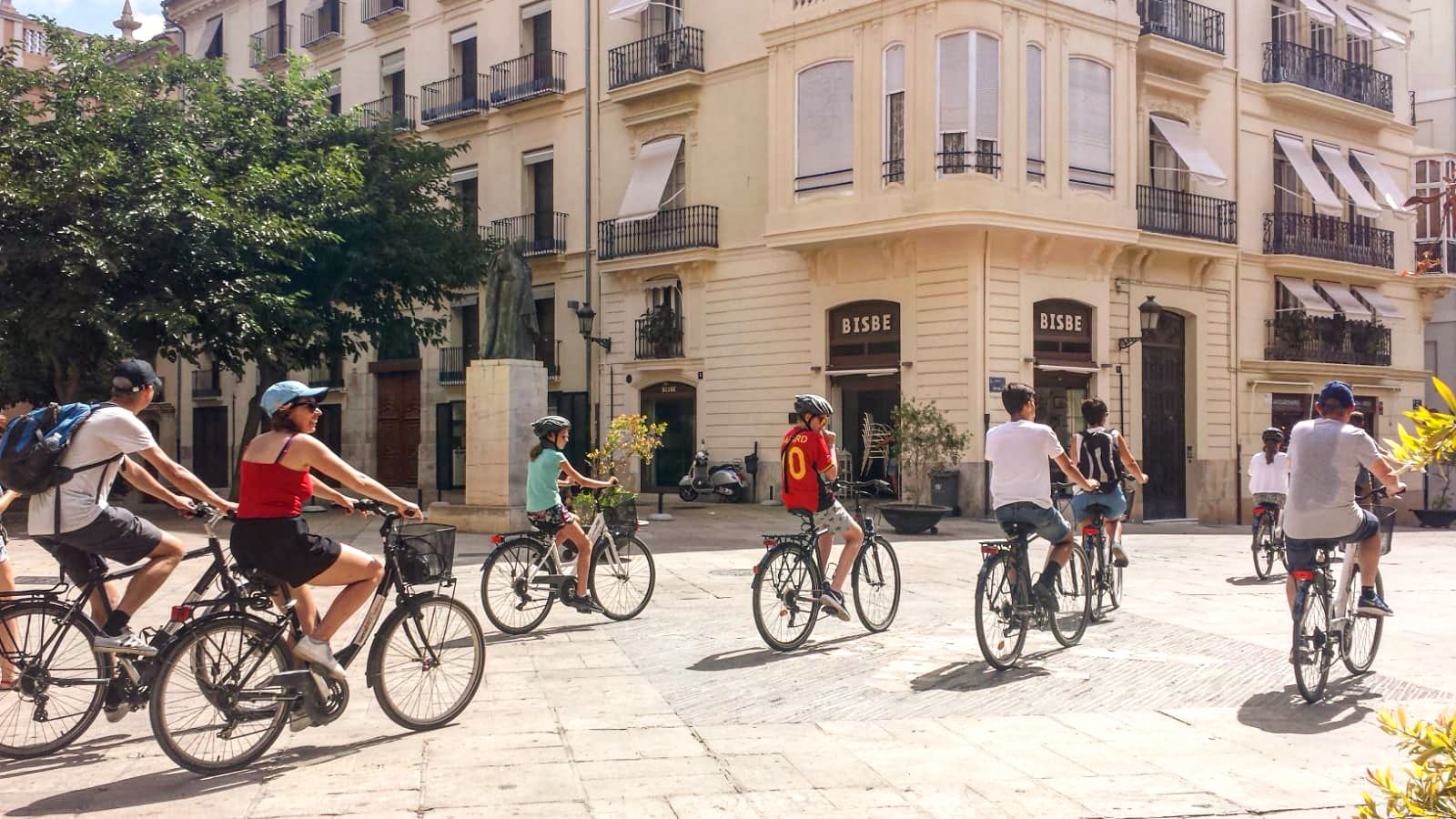 Tourists cycling in the city of Valencia, Spain