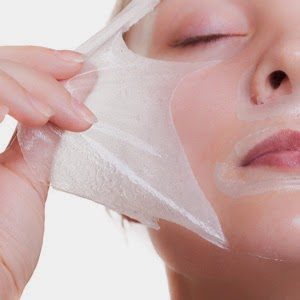Woman peeling mask from face