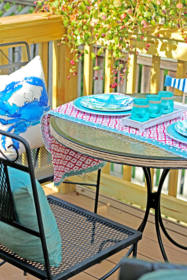 coastal decor patio set in floating deck.