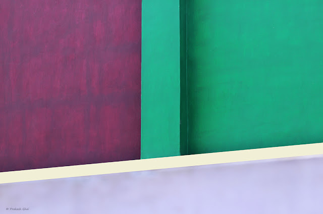 A Minimalist Picture of Colorful walls of a Kids School with Dark Violet, Green and Blue Wall Paint Colors