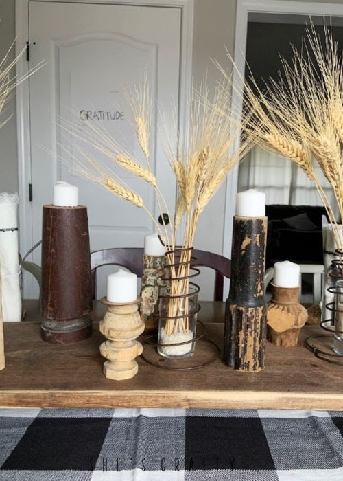 Thanksgiving table setting - centerpiece with vase of wheat and spindle candle holders