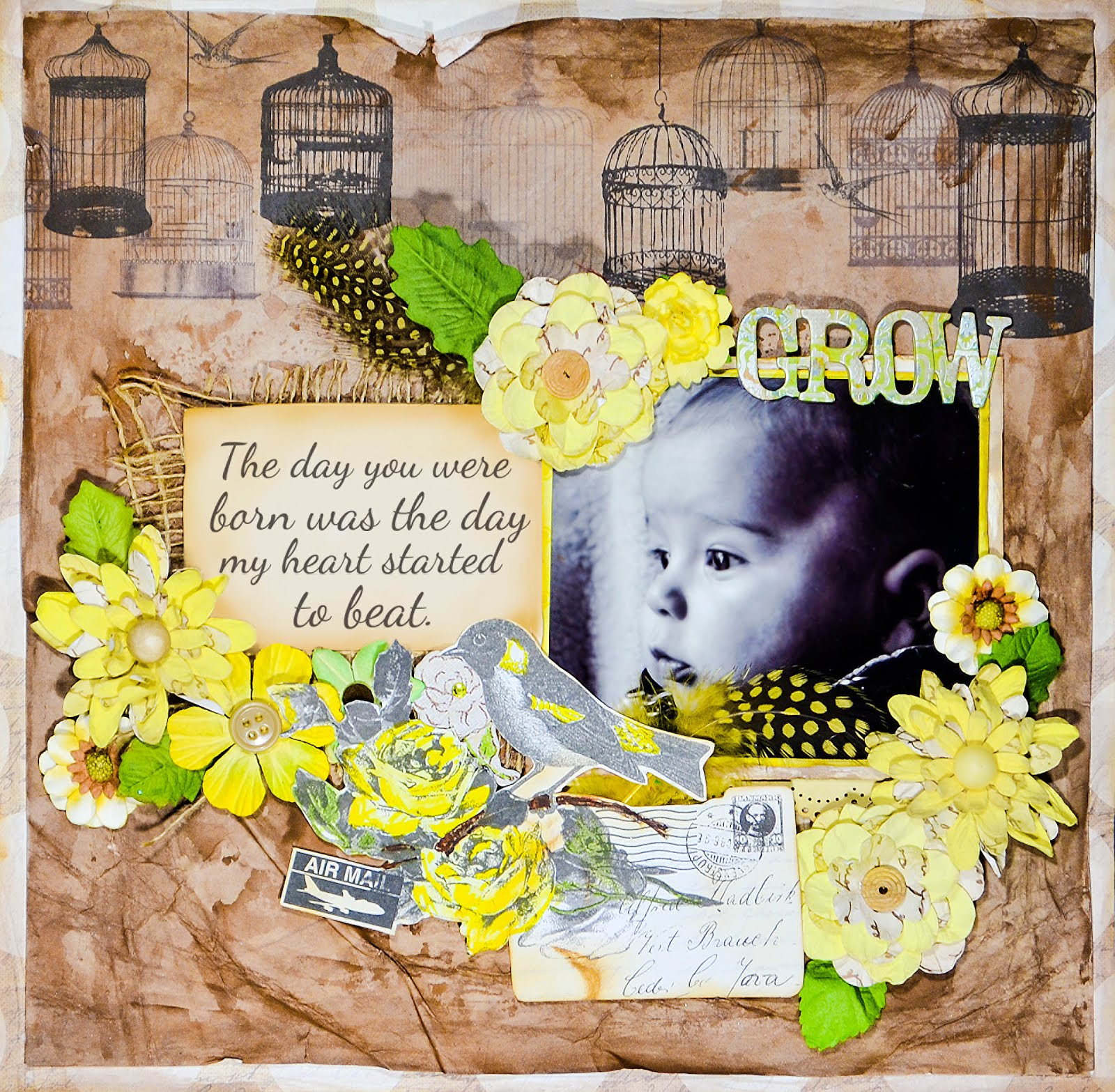 Scrapbook layout page in brown and yellow, featuring a bird theme and lots of flowers. Some mixed media painting in the background, too, with a couple fussy cuts.