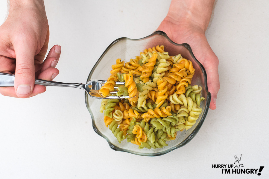 Pasta bowls with olive oil and herbs like basil, oregano, parsley