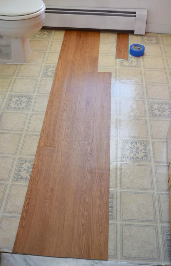 lay vinyl floor planks in bathroom