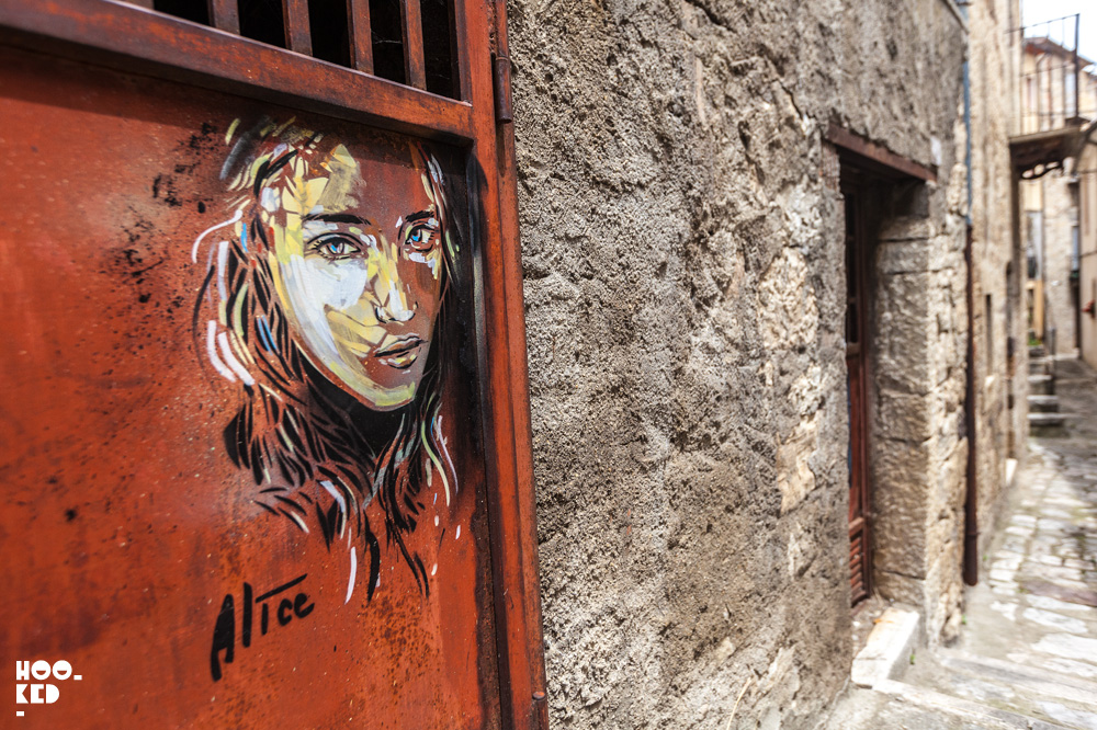 Street art in Civitacampomarano, Italy by street artist Alice Pasquini
