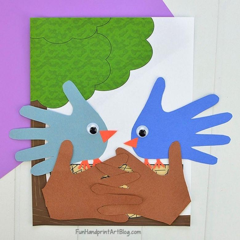 Spring crafts for kids - handprint blue bird craft