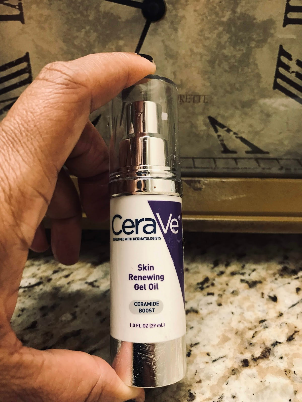Image: Woman holding CeraVe Oil for review. Oh my goodness this is a bit of heaven in a jar. I am not playing with you guys. it's small and a bit pricey (runs around 22 dollars) but it is so worth it. If you want that glowy and dewy skin feel and look. Hands down this are the product to grab. I will be buying two more bottles to keep under my cabinets. Because when I find something that is good and it works I will buy me a stash to keep as if the store is going to stop selling it. It has a silky and velvety feel that instantly improves skin radiance. After trying it, I can say it does just what it promises.