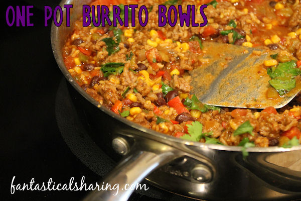 One Pot Burrito Bowls // A hearty, flavorful meal that you cook in one pot and serve up with as many or as few toppings as you want! #recipe #onepot #burrito #beef