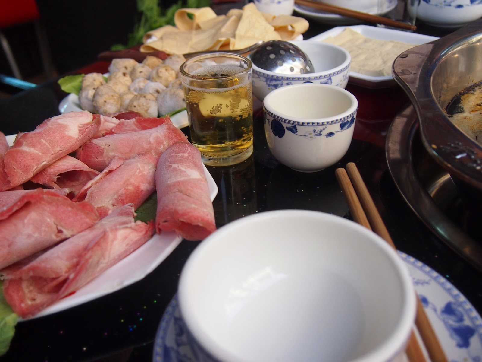 beer and uncooked food for hot pot