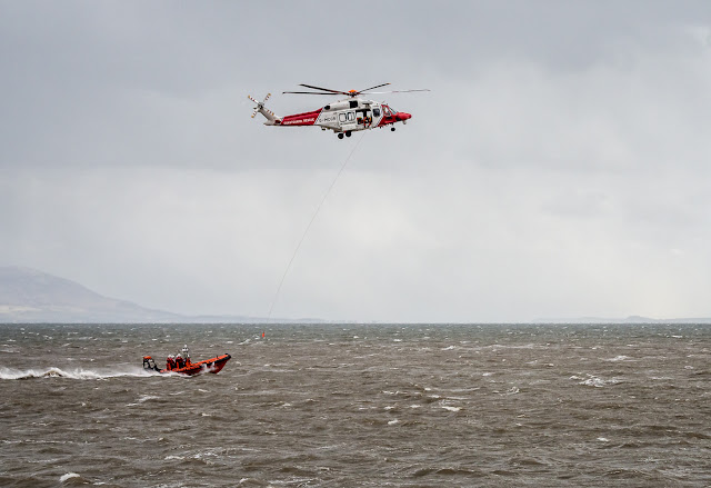 Photo of the Coastguard helicopter training with Maryport Inshore Rescue boat