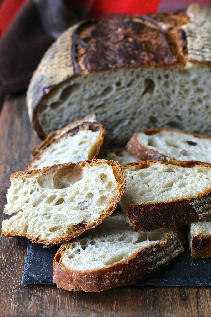 This Four Hour French Country Bread recipe will produce an artisan loaf with a crispy crust and a soft, moist, and, depending on how much water you add to the dough, an airy crumb.