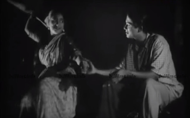 "Khan Ataur Rahman and Sumita Devi in Kokhono Asheni (1961) Movie       Md. Tanjir Alam   'Kokhono Asheni'(1961), is the first movie of Zahir Raihan as a director. The title of the film alludes to something which is normal however not found ever. 'Kokhono Asheni' the directorial debut of Zahir Raihan, is a landmark film in the history of Bangladeshi filmmaking. Although Raihan had previously worked as an assistant director to A J Karder in the film Jago Huya Savera, it is with Kokhono Asheni that he truly announced his arrival on the filmmaking stage. The film, however, was well received by critics as ground-breaking in its substance, style and narrative elements. It can be broadly categorized under the 'experimental art film' category, albeit feeling like a social melodrama.    'Kokhono Asheni' is set against the backdrop of 1960s Dhaka in the then East Pakistan. As such, it provides us with a rare opportunity to see life of the average middle-class Bangladeshi in Dhaka. The film essentially speaks to the account of a lower-class family, their life battle, a lady and her story and the musings of the general public of the 1960s in a very efficient account style. A rich individual named Sultan regards a lady as a model, as a piece of his own gallery whom he purchased with just 50 taka when she was a kid. However, the lady is youthful at this point. She needs to escape this historical center and needs to be dealt with like a human. She experiences passionate feelings for Shawkat, a youthful painter lives in alongside her structure.    Khan Ataur Rahman and Sumita Devi in Kokhono Asheni (1961) Movie     Shawkat's life as a bohemian artist perfectly illustrates the life of an artist in Dhaka during the 60s. Shawkat's choice of attire is something that is particularly striking when we talk about middle class sensibilities portrayed within the film. We also see Shawkat and his friends regularly hanging out at cafes partaking in the favourite Bengali pastime of 'Addabaji'. He holds art exhibitions of his work and critics and collectors seem to deem his work praiseworthy. Shawkat portrays the perfect embodiment of a chic young artist. She needs Shawkat remove her from this jail. Be that as it may, Shawkat isn't utilized. But Finally, he chooses childishly to leave his sisters all alone and to escape with Mariam. Be that as it may, he doesn't prevail to gather cash. He returns home discovers his sisters lying on the bed who as of now have done suicide and he himself additionally drinks some sort of toxic substance and bites the dust. Mariam attempts to escape the place of Sultan yet falls flat. Quite a while later, another family comes to live in a similar house Shawkat's family lived and Mariam is seen remaining in the gallery and watching them as past.    The film contains strong socio-political messaging by showing how the masses of the society is having to contend with the oppressive forces that the elites push down upon them through the capitalist mechanism. Zahir Raihan was known as being someone who prescribed to the communist philosophy and within 'Kokhono Asheni' we can see his ideals being reflected. Many film critics have also cited Raihan's films being his vessel to fight for the rights of people and for equality.    'Kokhono Asheni' makes particularly good use of symbolism to portray the socio-political tension that existed in society between the oppressors and the oppressed at the time. It might even be argued that Raihan was portraying the struggles of Shawkat, his family and Mariam as being representative of the struggle of the Bangladeshis against the Pakistani oppressors. I think this was Zahir Raihan's intention. Raihan was an ardent patriot and had been a very active activist in all forms of social causes and believed in using his films to give voice to the voiceless and the powerless.    The art collector, Sultan, represents the Pakistani despots. His description of his 'acquisition' of Mariam and her subsequent state of affairs bears a striking resemblance to the story of East Pakistan. When Sultan first takes Shawkat to his house to view his art collection, he tells him how he had 'freed' Mariam when he had acquired her. Yet, Sultan's definition of freedom might not match many of ours. This is very much symbolic of how East Pakistan gained independence as a nation from the colonial forces of the British in 1947 and yet, having gained supposed freedom, did not seem to enjoy any of the associated benefits of freedom. Just as Mariam had no agency or autonomy over her life, neither did East Pakistan over its affairs.    The film symbolizes the circumstance of the individuals of Bangladesh under the Pakistani system during the 1960s, when individuals of the nation were mistreated by the rulers. He sees Mariam as illustrative of East Bengal and Sultan as illustrative of West Bengal. Individuals of East Bengal attempted quite a while for their opportunity however it didn't come till the creation of the film as Mariam attempts to be free yet can't. Be that as it may, the chief keeps the expectation bursting at the seams with the shot of Mariam remaining in the overhang sitting tight for the opportunity.    The film begins with a title arrangement comprising of a moving image of a running wheel of a steed carriage distinctive still photos of the film. The stills are of various circumstances, of satisfaction, of pity. The running wheel is appeared between each two stills. This might be a sign towards life that there happen numerous things however life or time never stops. There might be distresses and more distresses from that point forward, yet at the same time, life goes on. Life continues relying upon the expectations. That is the reason we see the notorious shot of Mariam remaining in the gallery sitting tight for opportunity from beginning as far as possible.    Sumita Devi in Kokhono Asheni (1961) Movie     The plight of the middle class salary man is also vividly highlighted in Kokhono Asheni. When Shawkat's father loses his job, and eventually dies, the reality of living in a capitalist society as an artist dawns on him. The entire burden of providing for himself and his two sisters falls squarely on his shoulders. He is forced to give up on his bohemian way of life and look for work. Mariam, who he is in love with, also begs him to rescue her from Sultan but Shawkat cannot do so because he does not have the means. At this very critical juncture, he starts seeing his two sisters as being unnecessary burdens on him, people who are disposable from his life. Raihan shows how the capitalist institution slowly kills the artist's spirit and entraps him in society's pitfalls. Up until that point, we were shown a very loving relationship between Shawkat and his two sisters but when he eventually is faced with the choice of the responsibility of an elder brother, in the traditional Bangladeshi sense, versus pursuing his own desires, he chooses the latter. He in fact tells his two sisters via a letter, ""In this world we are all alone, I am going on my own path, you choose your own."" Thus, we can once again see Raihan critiquing the capitalist mandate of individualism over collectivism as this act by Shawkat effectively leads to the death of his two sisters.    However, the film did not legitimately include any political thought, its season of making and the characters make us accept it as a political film. In any case, the film worked too inconspicuously to depict the political circumstance. In the wake of finding the carcasses by the police, in the portrayal it is said that might be numerous months or numerous years after the fact, another family comes to live in the house. Time is kept covered up here. It might be in one side for being in the protected zone from the abusing government and on the opposite side for motivating the desire for opportunity in the psyche of individuals. Since upset may occur however there is no fixed time for this, it might happen soon or later yet one needs to trust in its plausibility.    ""A disconcerting conclusion might dictate itself; while they stress that 'every society' is shot through with class struggle with throughout the course of its development, and that all historical struggles are class struggles, Marx and Engels resort to their theory only intermittently"".    Khan Ataur Rahman and Sumita Devi in Kokhono Asheni (1961) Movie     Above the economic structure rises the superstructure, consisting of legal and political 'forms of social consciousness' that correspond to the economic structure. Marx says nothing about the nature of this correspondence between ideological forms and economic structure, except that through the ideological forms individuals become conscious of the conflict within the economic structure between the material forces of production and the existing relations of production expressed in the legal property relations.    The Marxist way to deal with culture alludes to the analysis of writings and practices in connection to their recorded state of generation. As indicated by Marx, each critical time of history is built around a specific method of generation where every method of creation produces explicit social connections among laborers and the individuals who control the method of generation. The point of departure of human history is therefore living human beings, who seek to satisfy certain primary needs. The first historical fact is the production of the means to satisfy these needs. This satisfaction, in turn, opens the way for new needs. Human activity is thus essentially a struggle with nature that must furnish the means of satisfying human needs: drink, food, clothing, the development of human powers and then of human intellectual and artistic abilities. In this undertaking, people discover themselves as productive beings who humanize themselves through their labor.  The separation between the common laborers and the decision class is evident the framework. Regular workers is overwhelmed and abused by the decision class. Laborers are estranged from their item which causes them to acknowledge the strength of the decision class. What's more, this occurs as a chain over and over with the exception of any insurgency occurs. This procedure is just depicted in the film where we see the families coming in the structure and biting the dust over and over.    ""Feminism is becoming an increasingly accepted part of ordinary social and political discourse, even if it is not viewed in the same light by everyone. Feminism is often represented in everyday discussions, as well as in lecture rooms, as a single entity and somehow concerned with equality.""    In this film 'Kokhono Asheni' the term feminism can be used to describe a political, cultural or economic movement aimed at establishing equal rights and legal protection for women. Feminism involves political and sociological theories and philosophies concerned with issues of gender differences as well as a movement that advocates gender equality for women and campaigns for women's rights and interests.     Kokhono Asheni is indeed a pleasure and a joy to behold. The acting by the cast are remarkable, the score and music is quite brilliant and Raihan's first effort as a director is more than just commendable. It is a landmark film in the Bangladeshi film industry that not has an abundance of style but substance in galore with important messages in an important period in the history of the people of this land.     Watch the full movie 'Kokhono Asheni (1961) directed by Zahir Raihan here..."
