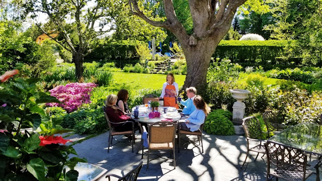 Several couples enjoying breakfast on the garden patio