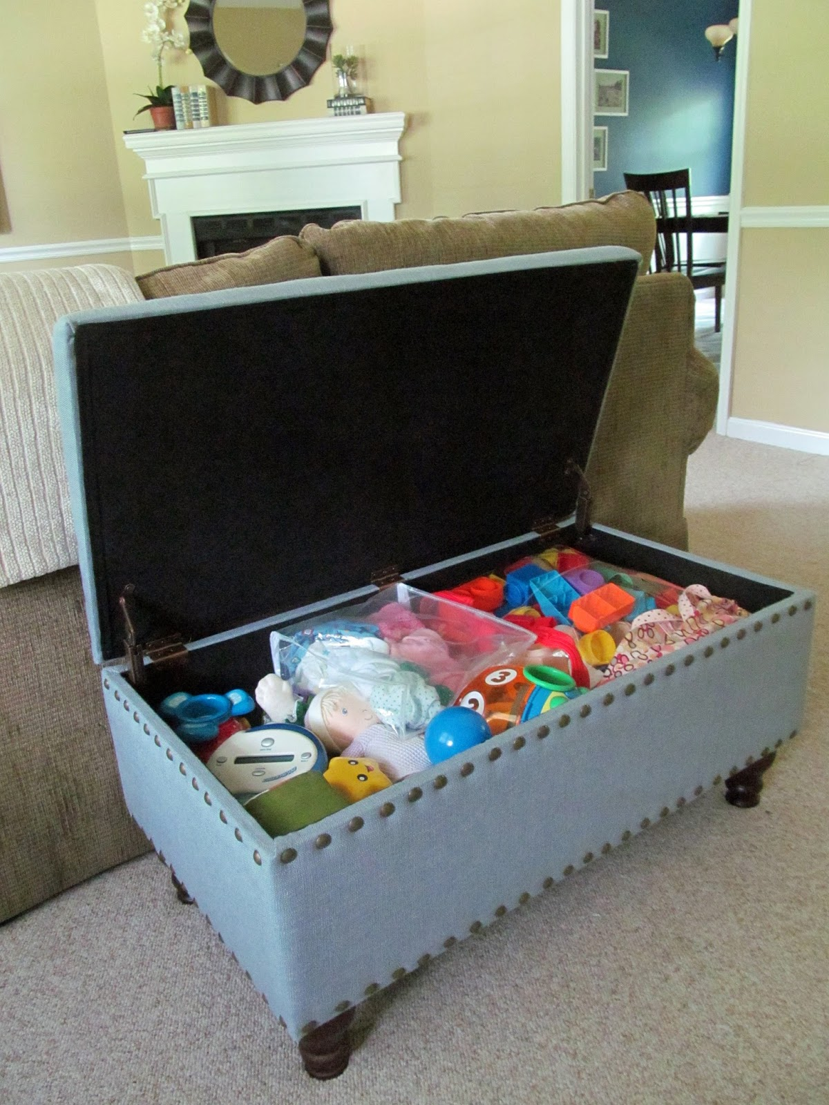 living room organizer my favorite way to hide toys in my family room 10666