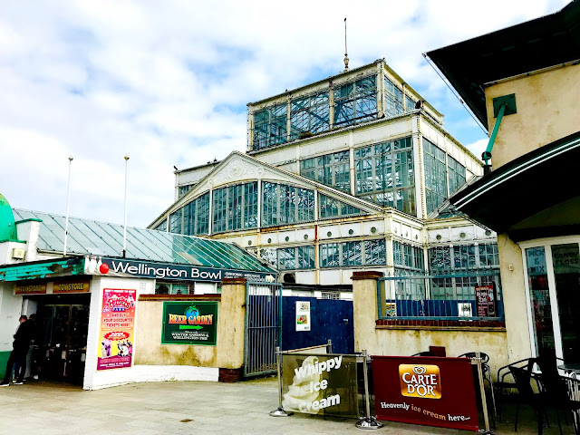 A view from Marine Parade to the Winter Garden in Great Yarmouth which is a bit like a large metal and glass greenhouse, photo taken in 2018