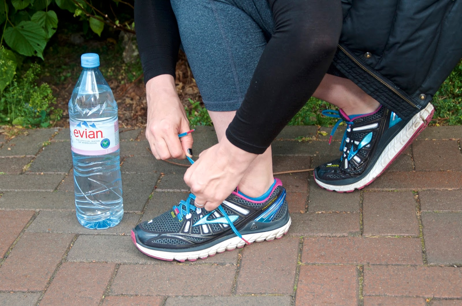 Evian water bottle, running shoes