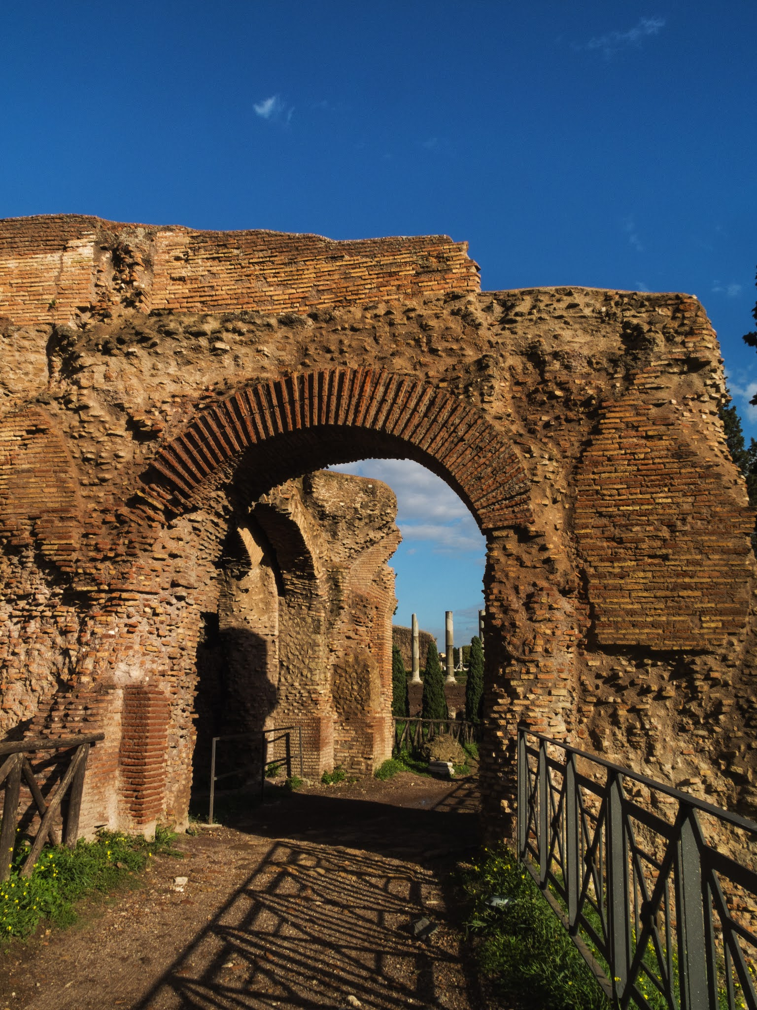 A red brick archway on Palatine Hill on a sunny day.