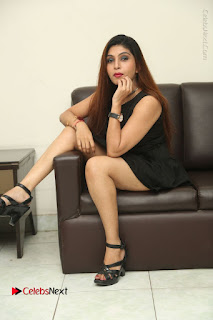 Tollywood Upcoming Actress Pooja Roshan Stills in Black Short Dress at Plus 1 Movie Trailer Launch  0334.JPG