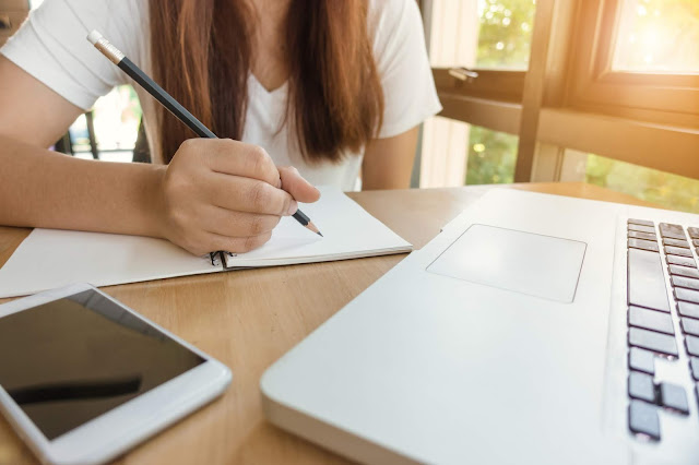 girl studying with electronic devices