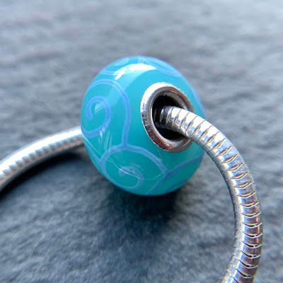 Handmade lampwork silver core big hole bead by Laura Sparling made with CiM Persian Green