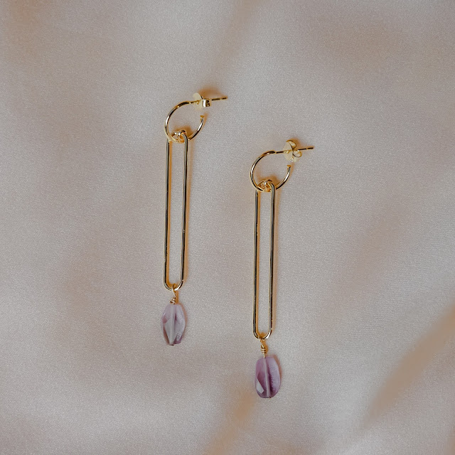 A pair of dangling stone earrings.