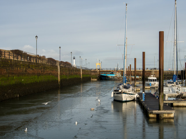 Photo of the gap in the ice leading from the other end of the marina