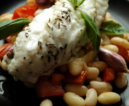 Roasted monkfish tails with garlic and basil and white beans