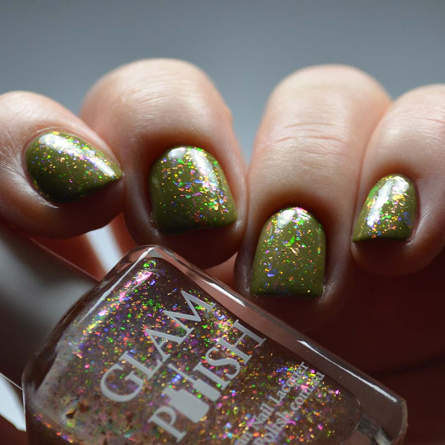 rainbow flakie nail polish over green swatch