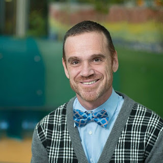 When Dogs Heal: A portrait of Dr. Rob Garofalo, smiling and wearing a bow tie. Dr. Rob is co-author of the amazing book, When Dogs Heal.