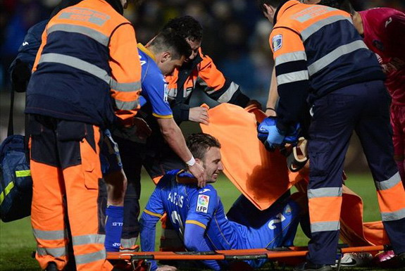 Getafe player Alexis is helped onto a stretcher after he broke veins in his testicle