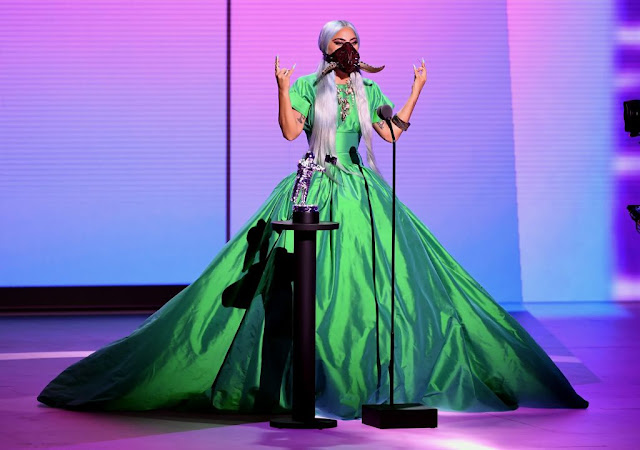 Lady Gaga is wearing a Christopher John Rogers dress