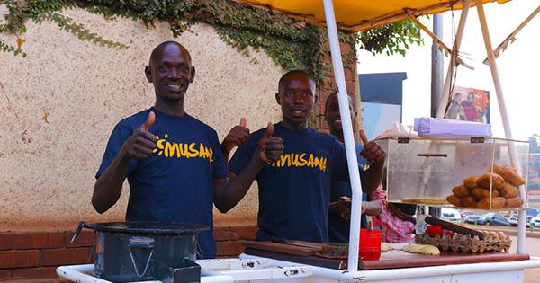 Black street vendors in Uganda using Musana Carts