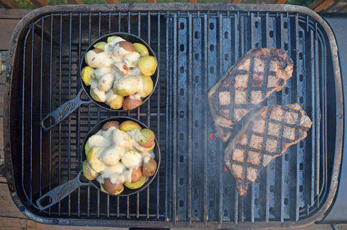 Certified Angus Beef Brand NY Strip Steaks from Food City on the grill
