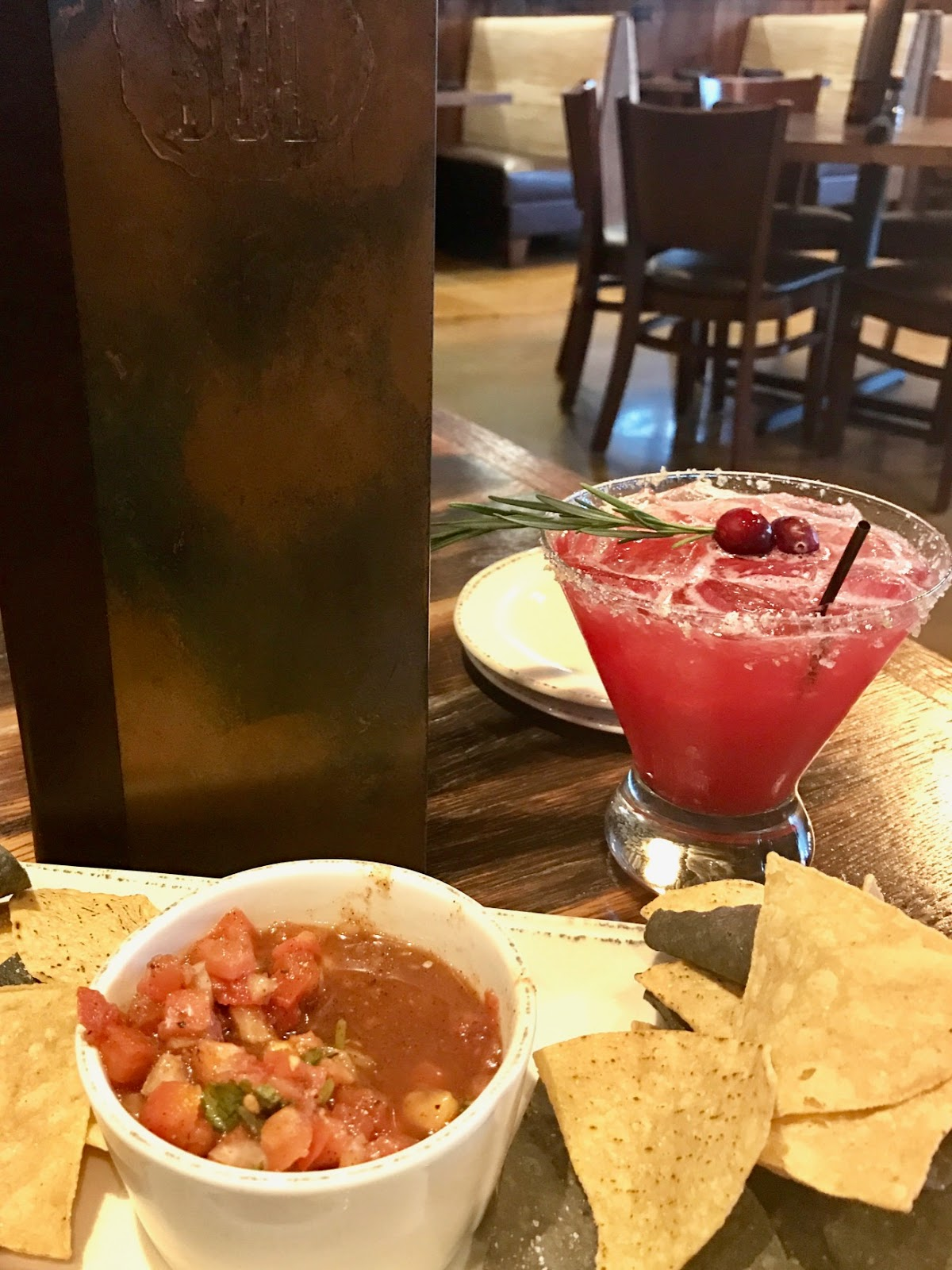 chips and salsa with holiday themed cranberry spiced margarita from SOL Southwest Kitchen
