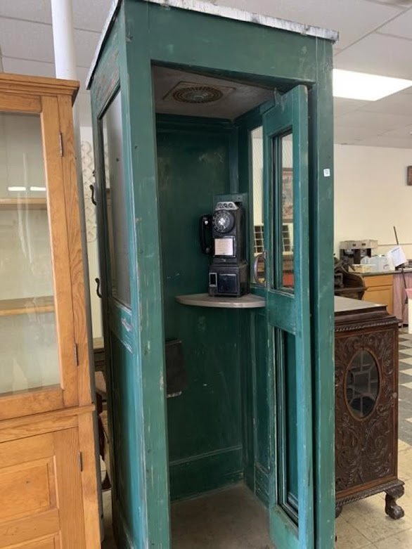 Bidding at online auction -- phone booth
