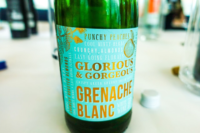 A close up of a mint green, white and gold label for Grenache Blanc
