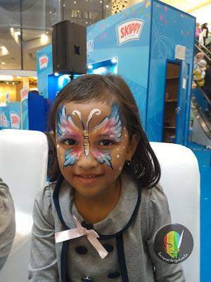 face painting kupu-kupu biru
