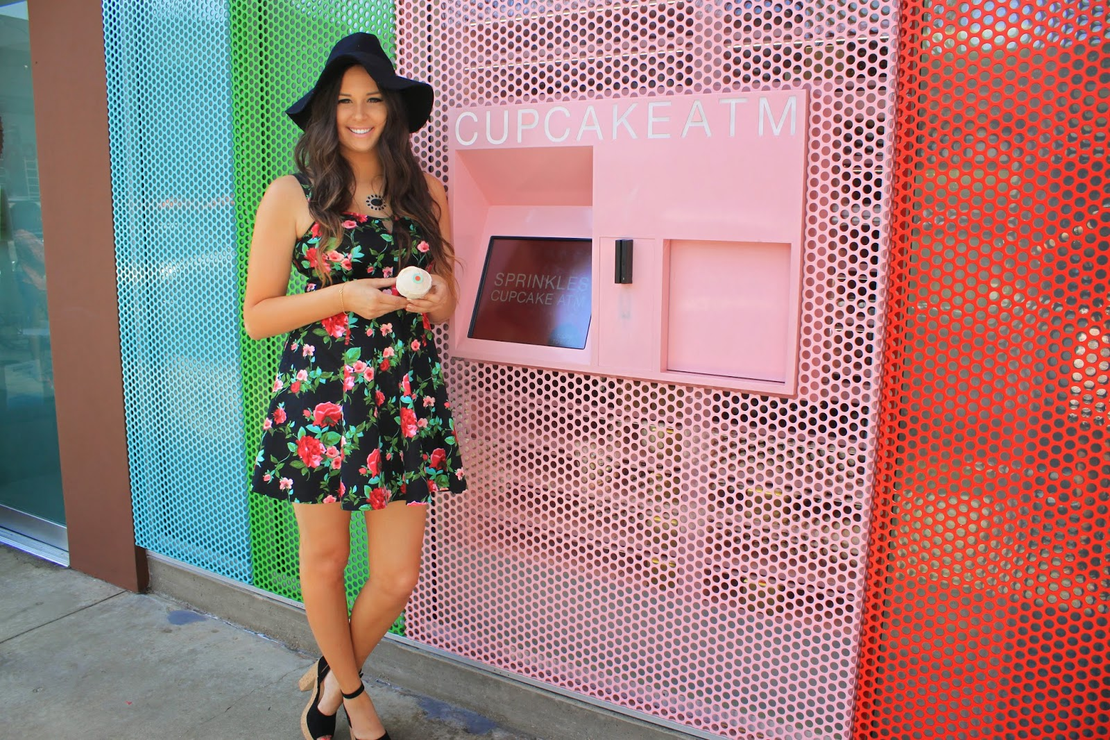 Fashion blogger Mash Elle at Sprinkles Cupcake on Rodeo Drive in Beverly Hills